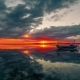 Сlouds and Sunset Reflected in the Water on the Island of Gili, Indonesia - VideoHive Item for Sale