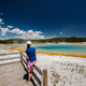 Woman tourist overlooking thermal spring in Yellowstone - PhotoDune Item for Sale