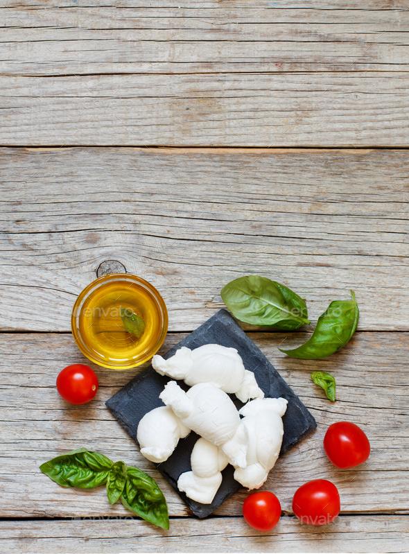Italian cheese mozzarella nodini with tomatoes and herbs - Stock Photo - Images
