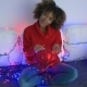 Coquettish Model in Sweater with Twinkle Lights