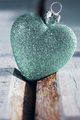 Christmas bauble heart on a wooden background. - PhotoDune Item for Sale