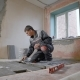 Construction Worker Using Plastering Tools Renovating Apartment House. Construction Work Starts - VideoHive Item for Sale