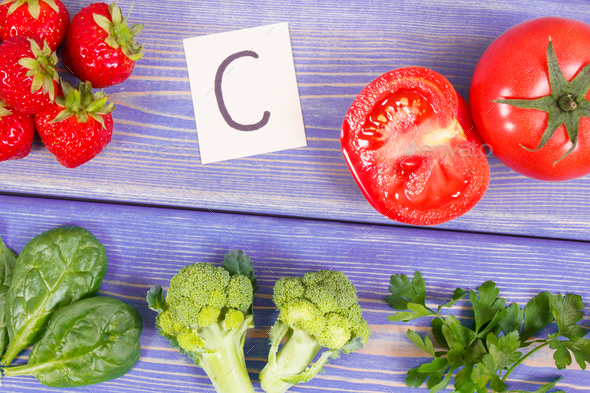Fruits and vegetables containing vitamin C and minerals - Stock Photo - Images