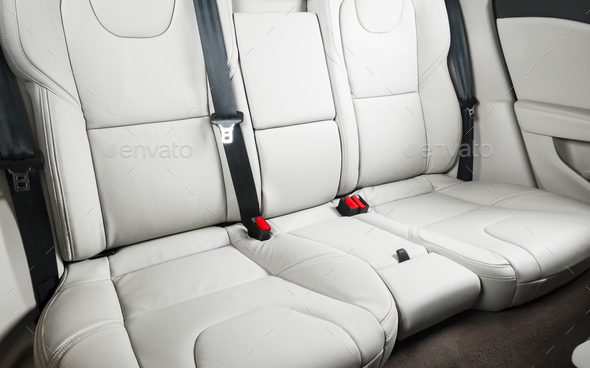 back seats of modern luxury car, white leather interior - Stock Photo - Images