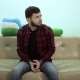 Young Man Sitting on Sofa and Waiting for His Appointment - VideoHive Item for Sale