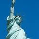 Statue of Liberty in a sunny day, blue sky in New York - PhotoDune Item for Sale