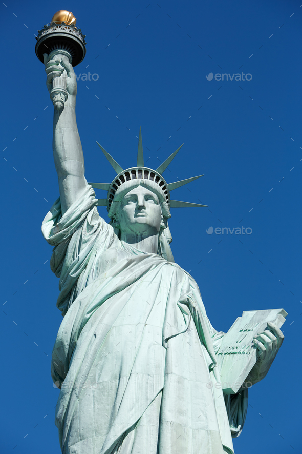 Statue of Liberty, clear blue sky - Stock Photo - Images