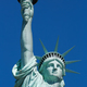 Statue of Liberty upper part in a sunny day, blue sky, New York - PhotoDune Item for Sale