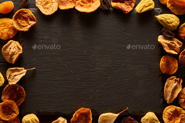 Dried fruits on slate plate - Stock Photo - Images
