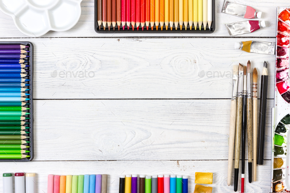 Artist workspace on white wooden background. - Stock Photo - Images