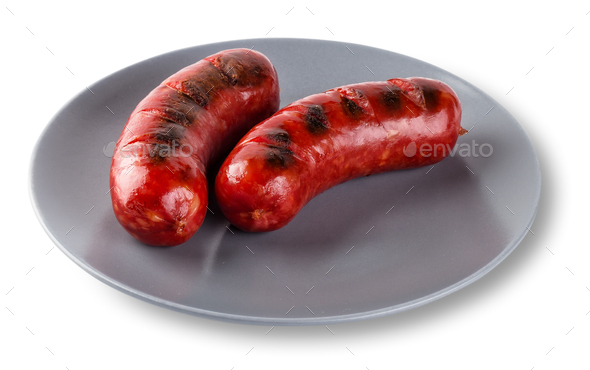 Two fried sausages on gray plate isolated on white background - Stock Photo - Images