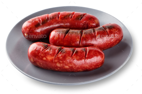 Grilled sausages cooked on a grill in gray plate - Stock Photo - Images