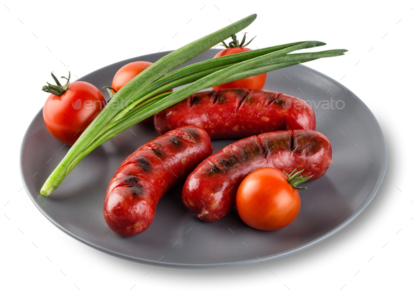 Attractive sausages with tomatoes and onions  on gray plate - Stock Photo - Images