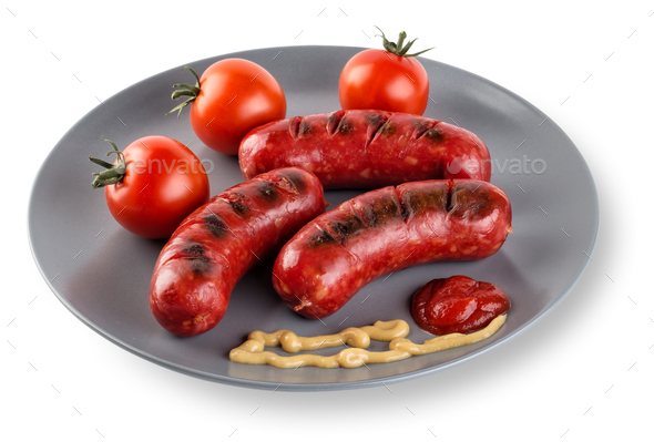 Fried sausages with tomatoes mustard and ketchup on plate - Stock Photo - Images