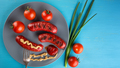 Nutritional sausages strung on fork with red tomatoes on plate - PhotoDune Item for Sale