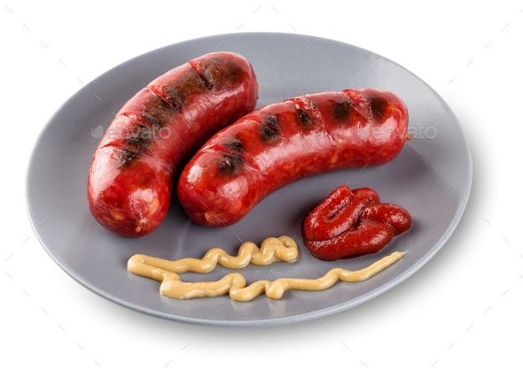 Sausages lying on gray  plate with mustard and ketchup - Stock Photo - Images