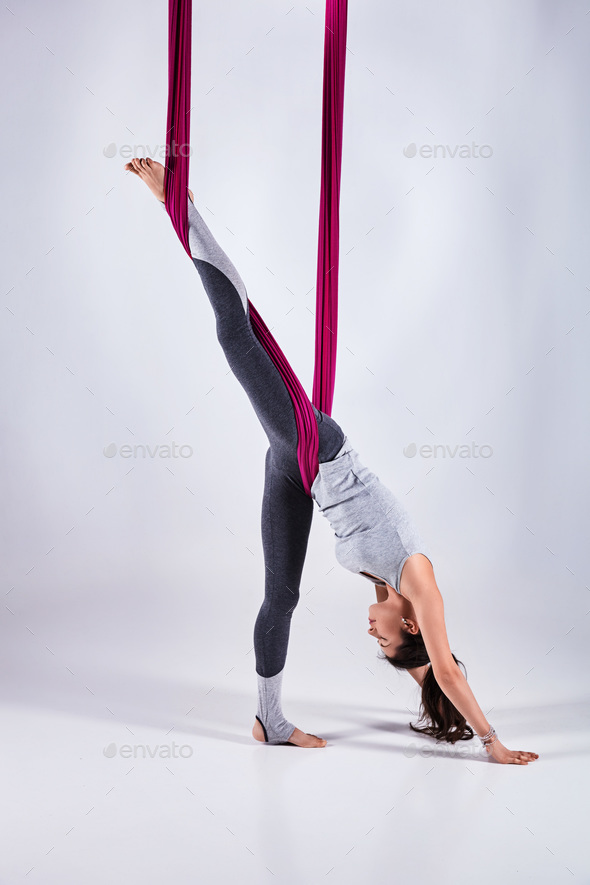 Aerial different inversion antigravity yoga in a hammock - Stock Photo - Images