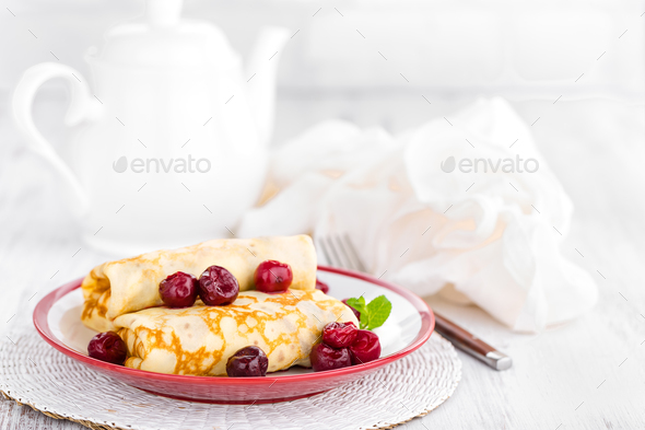 Sweet pancakes with cherry - Stock Photo - Images