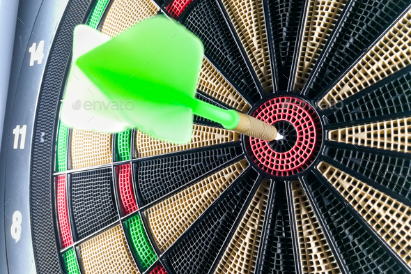 Close-up on dart pin on board bullseye - Stock Photo - Images