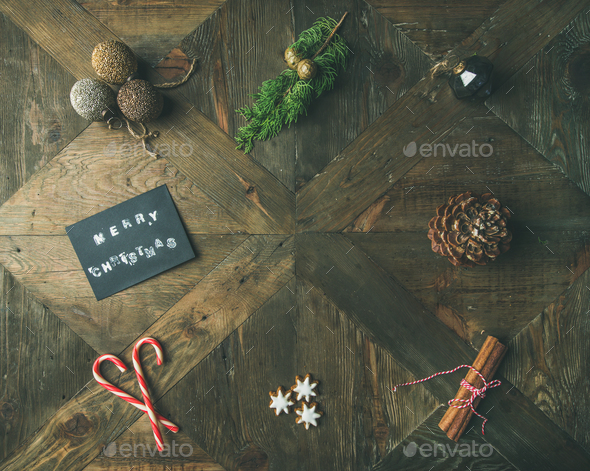 Flat-lay of greeting card, cinnamon, candy cane, top view - Stock Photo - Images