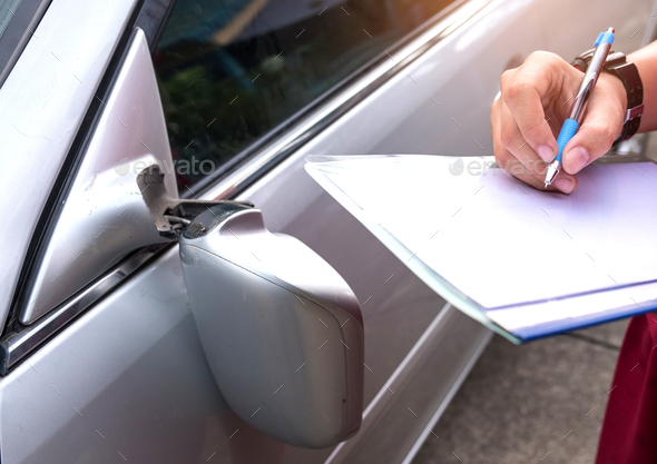 Insurance Officer Checking car accident,Car accident  broken sid - Stock Photo - Images