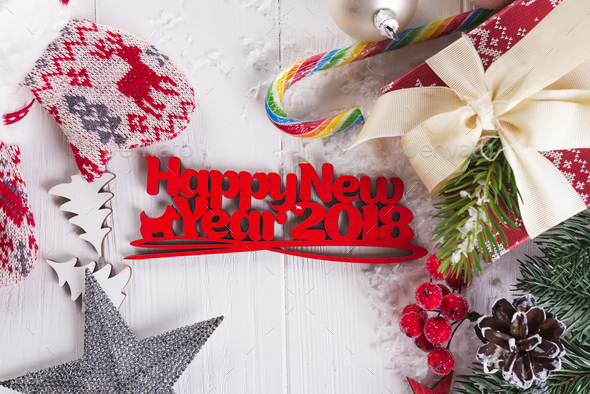 New year background with gift boxs, christmas tree, mittens and decorations - Stock Photo - Images