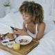 Pretty Model Having Meal in Bed