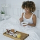 Content Woman Having Breakfast in Bed