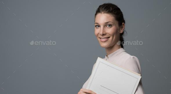 Secretary holding a folder - Stock Photo - Images