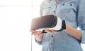 Woman holding a VR headset - PhotoDune Item for Sale