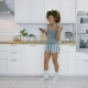 Young Woman Dancing in Kitchen with Smartphone - VideoHive Item for Sale