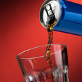 Pouring a soft drink in a glass - PhotoDune Item for Sale