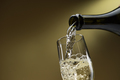 Pouring white wine into a wineglass - PhotoDune Item for Sale