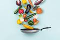 Fresh healthy vegetables falling in a pan - PhotoDune Item for Sale
