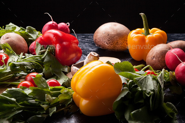 Red and yellow pepper, mushrooms and greenery - Stock Photo - Images