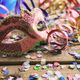 Carnival party. Mask, confetti and serpentines on wooden background - PhotoDune Item for Sale