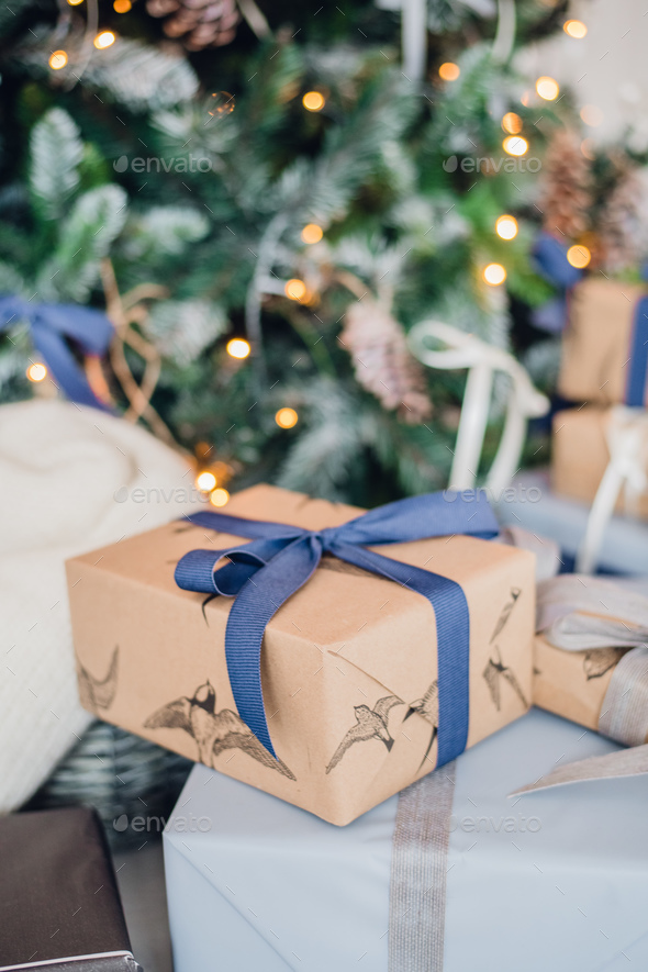 Christmas gift or present box wrapped in kraft paper on christmas decoration - Stock Photo - Images
