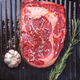 marble beef steak roasting in grill pan with garlic and rosemary - PhotoDune Item for Sale