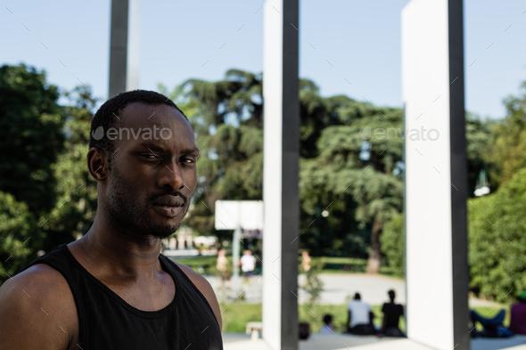 Portrait of a black man in a city park - Stock Photo - Images