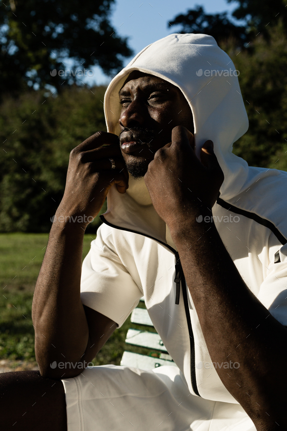 Portrait of a black man in a city park - Stock Photo - Images
