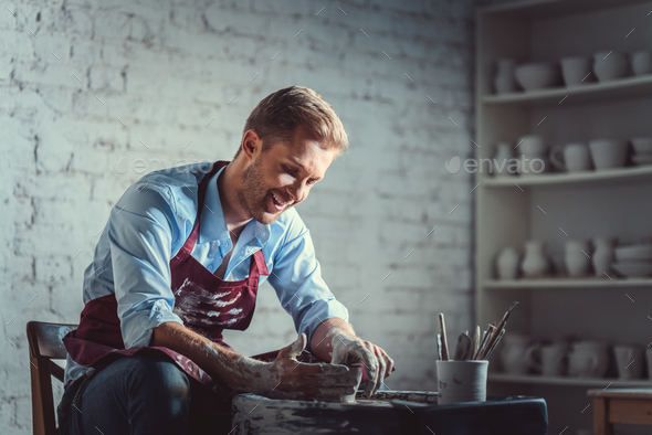Smiling potter - Stock Photo - Images
