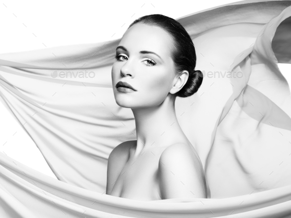 Portrait of young beautiful woman against flying fabric. Beauty - Stock Photo - Images