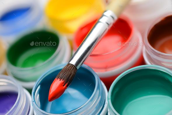 Gouache paint jars and paintbrush - Stock Photo - Images