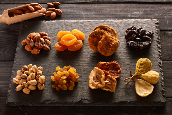 Dried fruits and nuts on slate plate - Stock Photo - Images