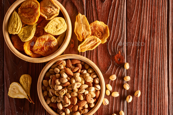 Dried fruits and nuts on wooden background - Stock Photo - Images