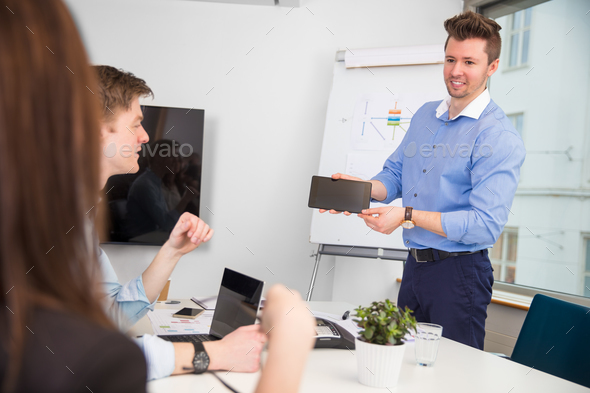 Businessman Showing Digital Tablet To Colleagues - Stock Photo - Images