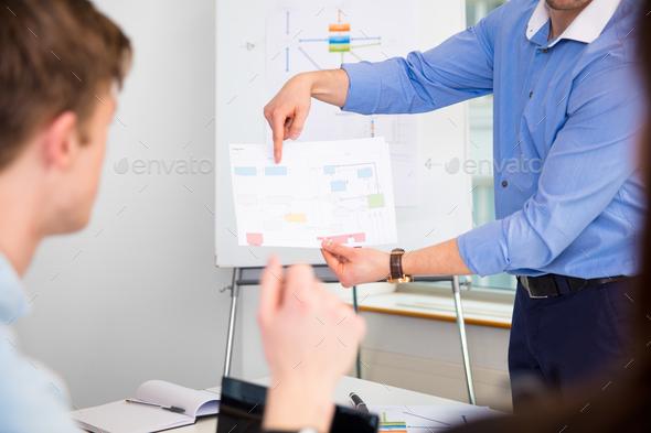 Professional Showing Chart To Coworker In Office - Stock Photo - Images