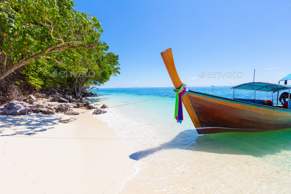 Longtail Boat Moored At Aonang Beach Against Sky - Stock Photo - Images