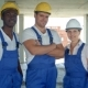 Confident Diverse Team of Workmen and Women Standing Grouped in Their Dungarees - VideoHive Item for Sale