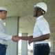 Handsome Construction Businessmans in Protective Helmets and Vests Are Shaking Hands at Construction - VideoHive Item for Sale
